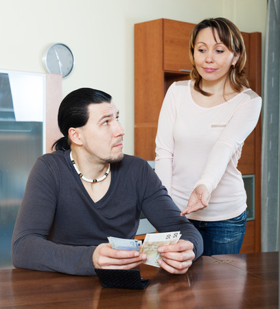 Woman asking for money from husband