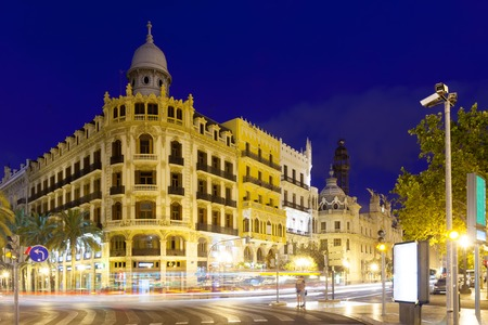 View of city street in night - Placa del Ajuntament. Valencia, Spain