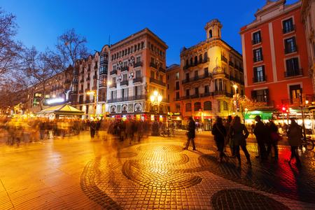 BARCELONA, SPAIN - MARCH 13, 2014: Pavement mosaic by Joan Miro on la Rambla in evening