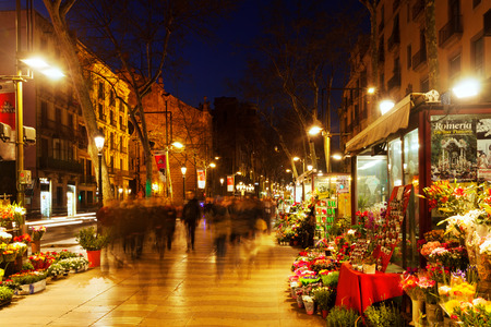 BARCELONA, SPAIN - MARCH 13, 2014: Flower kiosks on la Rambla in night. La Rambla one of symbol of city