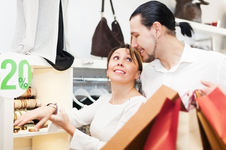 Young man and woman choosing  bracelet at store photo
