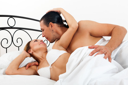 adult sex: adult couple having sex on bed in home   Stock Photo