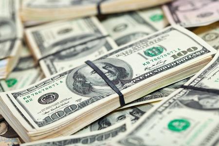 ing: Background of many US dollars banknotes Stock Photo