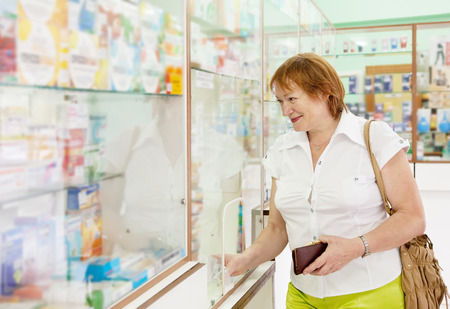 Mature woman buys drugs at the pharmacy Stock Photo - 27537907