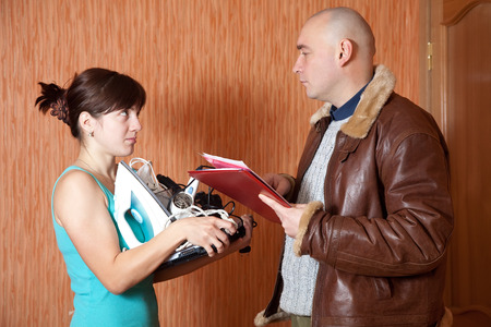 rapacity: businessman trying to collect debt  from woman Stock Photo
