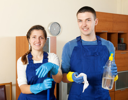 company premises: Team of cleaners cleaning in room