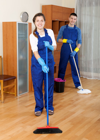Cleaning team in uniform is ready to work in room photo