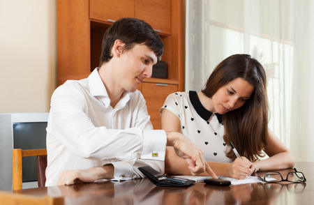 parsimony: Quarrel in young family over  financial documents Stock Photo
