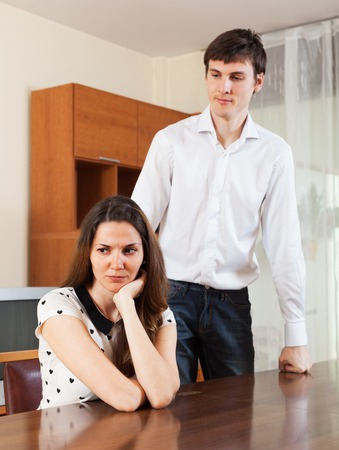conflicting: Unhappy girl conflicting with boyfriend at home Stock Photo