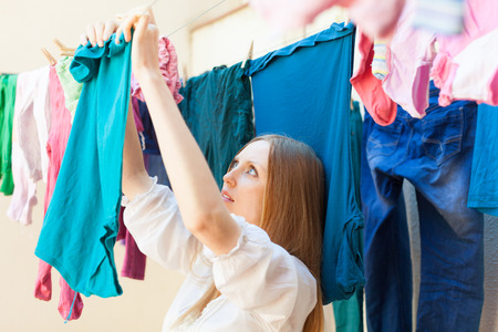 laundry line: housewife drying clothes on clothes-line after laundry Stock Photo