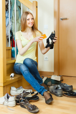 Happy  housewife with shoes at home photo