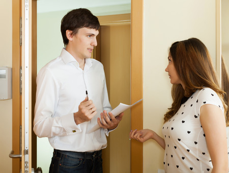 social worker:  woman questionnaire for male social worker or employee at door