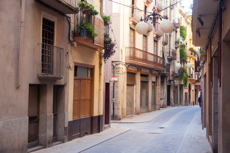 alt: VALLS, CATALONIA - JANUARY 26, 2014: Town street. Valls is the capital of the comarca of Alt Camp. Population (2010) 25,158