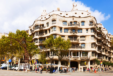 BARCELONA, CATALONIA - SEPTEMBER 12: Casa Mila (La Pedrera) on September 12, 2013 in Barcelona, Catalonia.  House was built in 1905–1910 by Catalan architect Antoni Gaudi