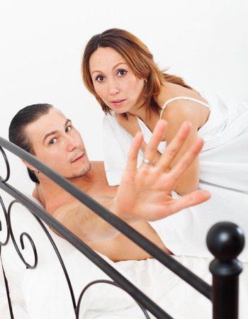 Middle-aged couple caught during adultery in bed photo