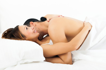 man and girl having sex on white sheet in bed   photo