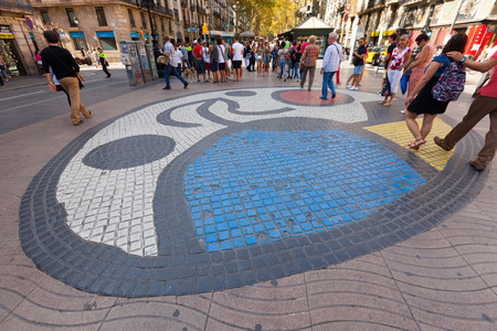 BARCELONA, SPAIN - SEPTEMBER 12: Pavement mosaic by Joan Miro on la Rambla on September 12, 2013 in Barcelona, Spain