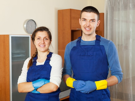 houseman: Handsome cleaners cleaning living room at home