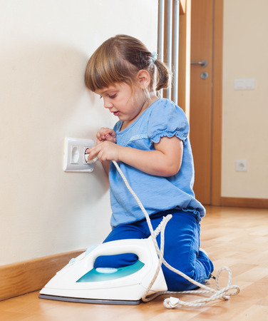riskiness:  3 years  girl  playing with electric iron at home