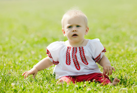 baby in traditional folk clothes photo