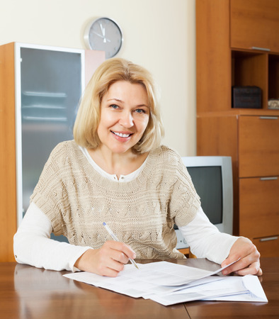 fifty something: Portrait of mature woman with  documents