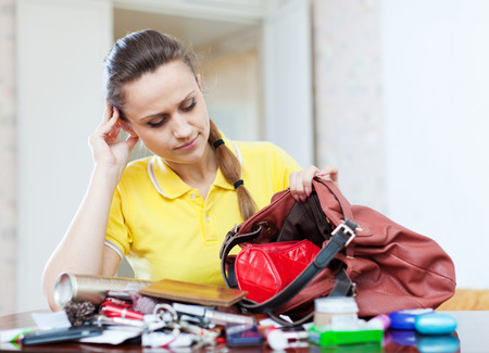 ransack:  inconsiderate woman lost something and finding in handbag Stock Photo