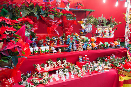 BARCELONA, CATALONIA - DECEMBER 12: Flowers and gifts at counter of kiosk on December 12, 2013 in Barcelona, Catalonia. Christmas market near Sagrada Familia