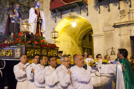 holy week: ALICANTE, SPAIN - APRIL 14, 2014: Night procession during Holy Week in Spain. Holy Week is  annual commemoration  by Catholic religious brotherhoods, processions on  streets of Spanish city and town