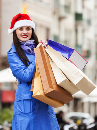 Woman with shopping bags at street during the Christmas sales photo