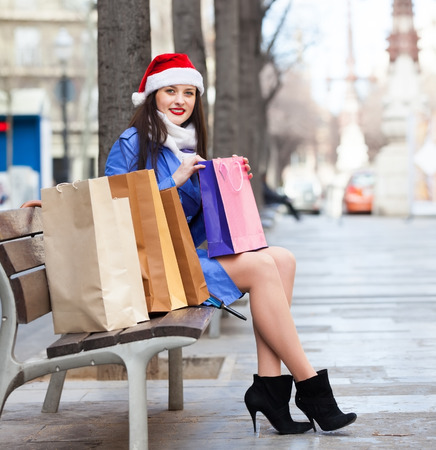 Happy woman with shopping bags at street during the Christmas sales photo