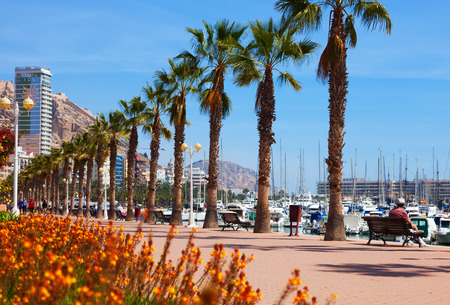 ALICANTE, SPAIN - APRIL 14, 2014: Embankment in Alicante. Avenue Admiral July Guillen Tato. Place for walking people at port side Editoriali