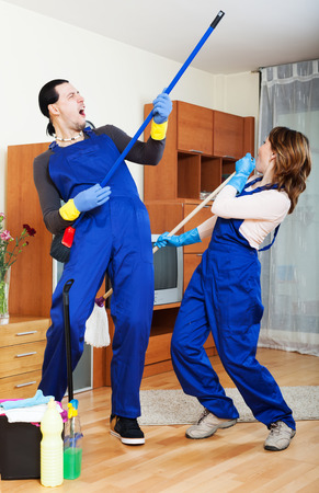 impish: Playful cleaning premises team is ready to work Stock Photo