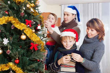 family at Christmas time or winter holiday season photo