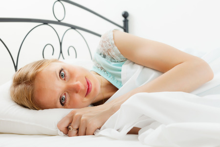 awaking: Pretty woman awaking in her bed at home