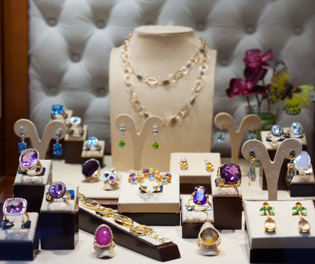 jewelry with gems at showcase of  shop photo