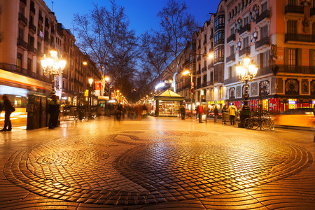 BARCELONA, SPAIN - MARCH 13, 2014: Pavement mosaic by Joan Miro on la Rambla in night. Barcelona