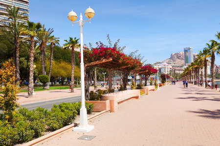 ALICANTE, SPAIN - APRIL 14, 2014: Embankment in Alicante. Avenue Admiral July Guillen Tato. Place for walking residents and vacationers at seaside