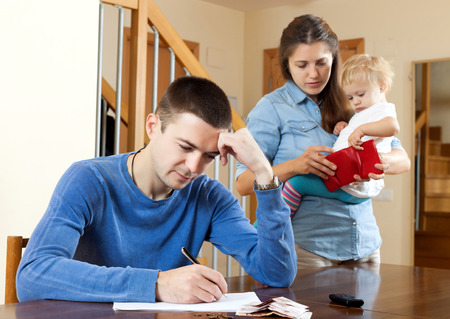Financial problems in family of three. photo