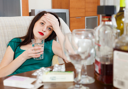 Suffering woman after celebrating of holiday