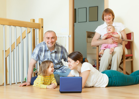 Happy multigeneration family together at home interior photo