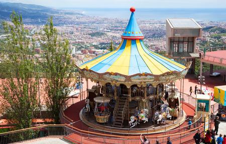 tibidabo: BARCELONA, SPAIN - MAY 18: Carrousel at Tibidabo Amusement Park in May 18, 2013 in Barcelona, Spain.  Park  is the oldest amusement park in Spain Editorial