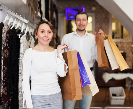 Man and woman with shopping bags at clothing shop photo