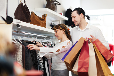 Couple choosing  sweater at clothing shop photo