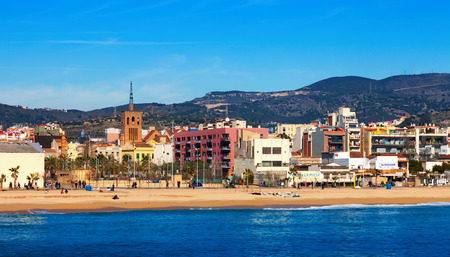 3rd century: BADALONA, SPAIN - MARCH 2, 2014: Mediterranean sand beach in Badalona, Spain. City was founded by the Romans in the 3rd century BC. Now it is one of the centers of a beach holiday in Europe