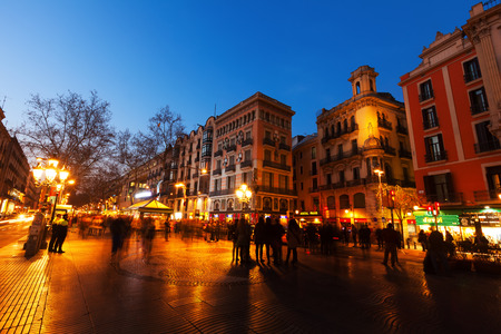 BARCELONA, SPAIN - MARCH 13, 2014: La Rambla in evening. Barcelona, Spain. La Rambla one of symbol of city. Located between El Raval and Barri Gotic districts