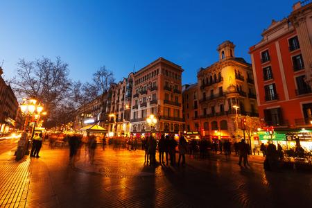 BARCELONA, SPAIN - MARCH 13, 2014: La Rambla in evening. Barcelona, Spain. La Rambla one of symbol of city. Located between El Raval and Barri Gotic districts
