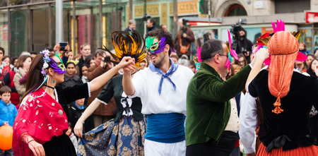 mummery: BARCELONA, SPAIN - MARCH 2, 2014: Dancing people at Carnival Balls to the Popular Culture and Traditional Catalan Editorial