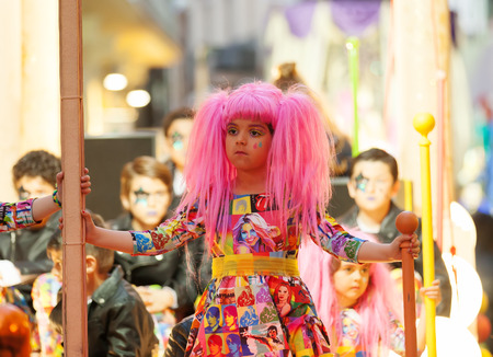 mummery: SITGES, SPAIN - MARCH 5, 2014: Girl at procession of burial Carnestoltes  - Burial of the Sardine at Sitges in evening