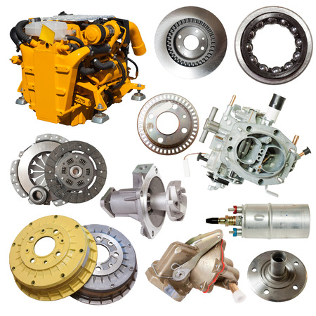 motor and few automotive parts. Isolated over white   Banco de Imagens
