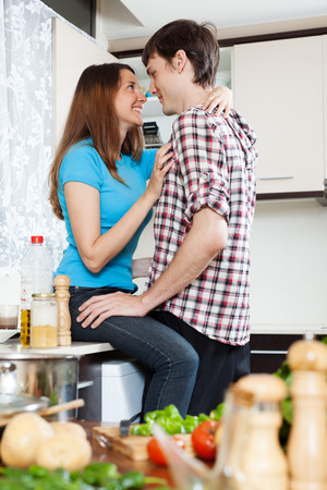having sex: Young loving couple having sex at domestic kitchen Stock Photo